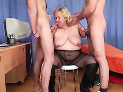 Busty blonde old grandma gulps two dicks