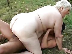 A man in terrible mask fucks fat woman
